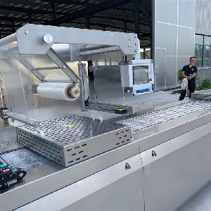 【一机多用】连续式拉伸膜真空包装机 米团真空包装机